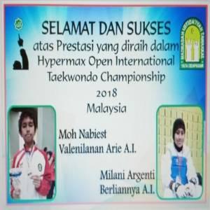 juara dalam hypermax open international Taekwondo Championship